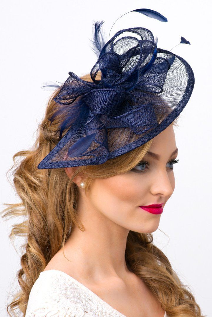 e915e4ac7b90b This sassy fascinator is timeless glamour, and a nod to vintage style with  bouncy mesh ribbon and flighty feathers. Classic sinamay mesh shape and  elegant ...