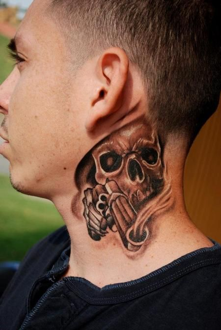 skull with gun tattoo on man side neck tatoos