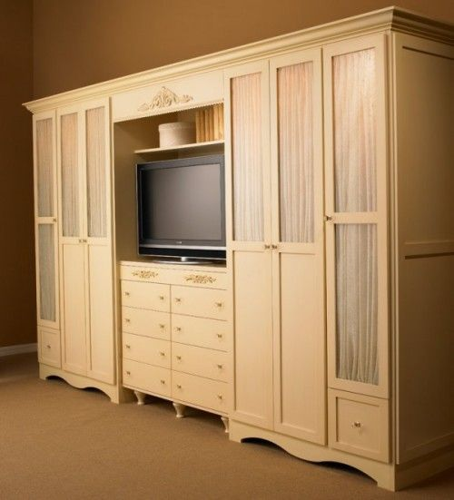 This style of clothes unit with spot for a tv http www for Bedroom wall units with wardrobe for small room
