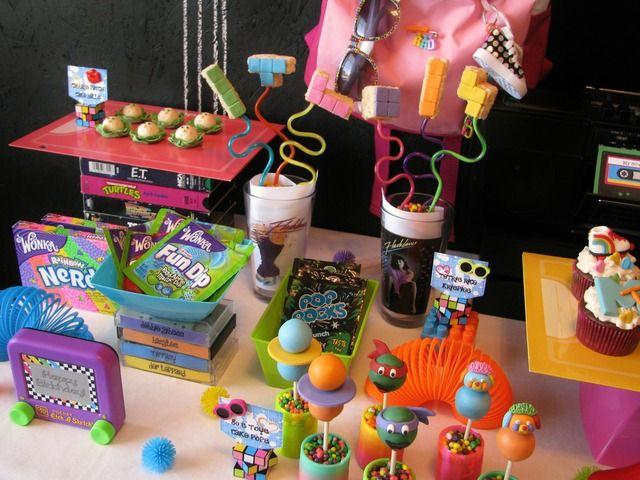 80's party: nerds, poprocks, fundip, twisty straws, tetris pieces out of ricekrispie treats, ninja turtles and slinky