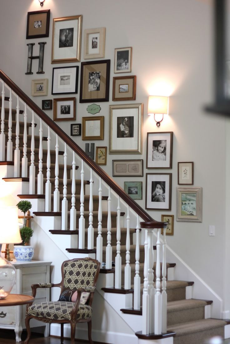 """how to do a gallery wall """"right"""" (""""rough draft"""" with measured paper labeled w each piece + easily movable painter's tape; good mix of photos vs. art; mount lower than you think you want for viewability from first floor)"""