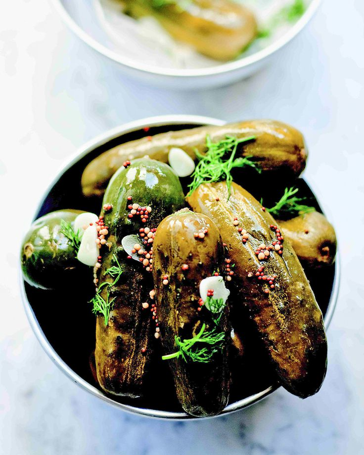 """Kirby cucumbers, sliced garlic, and chopped fresh dill add up to flavorful, crunchy pickles. This easy-to-make pickle recipe is from Bruce and Eric Bromberg's """"Blue Ribbon Cookbook."""" Use the pickles as a topping for barbecued meat sandwiches or a simple snack for any time of day."""