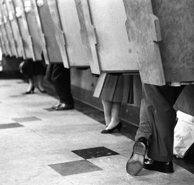 Customers in listening booths at an HMV record shop in London, June 20, 1958.