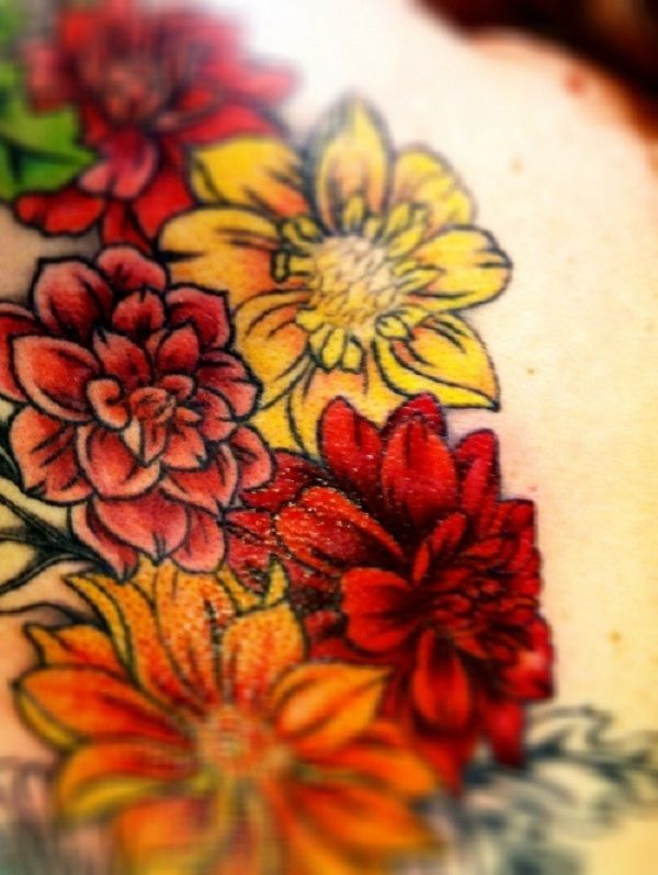Green, red and yellow flower tattoo #TattooModels #tattoo