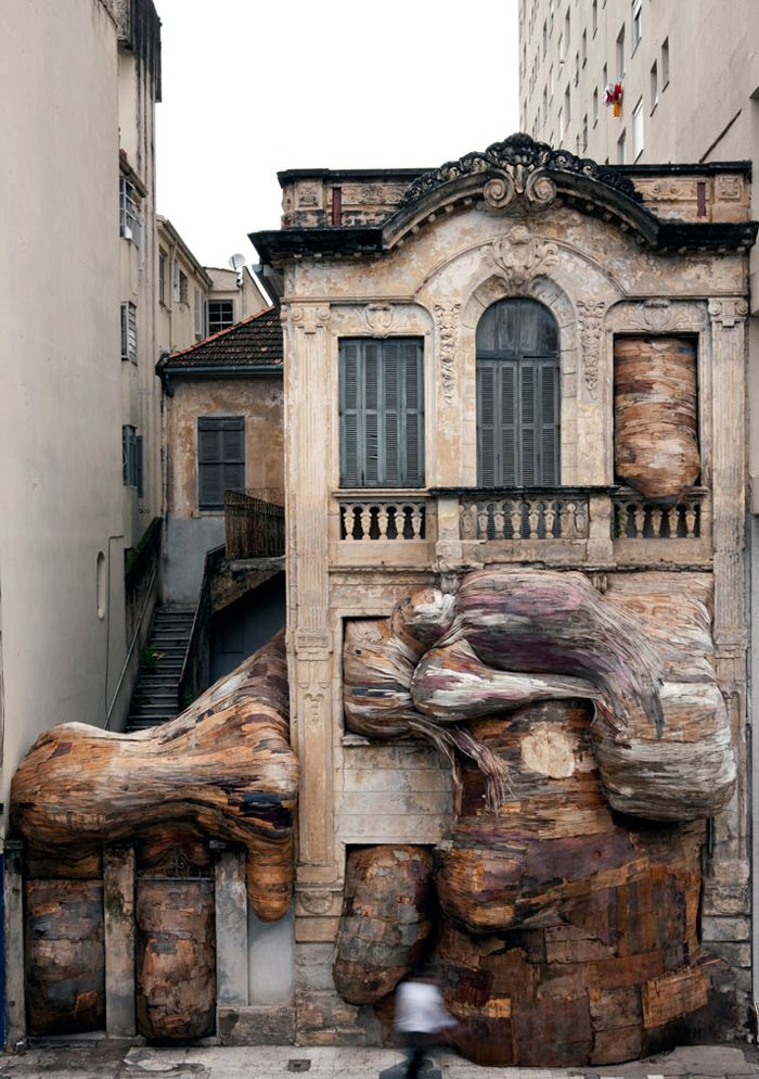 Henrique Oliveira. Creates tree trunk art that seem to burst through walls - all made with discarded wood - this guy blows my mind!