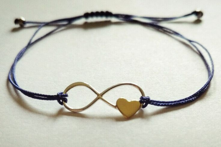 Sterling Silver Infinity Link Bracelet with Tiny Bronze Heart by Bohemicin on Etsy