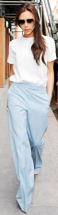 Victoria Beckham in pale-blue Chloe trousers, and simple white top