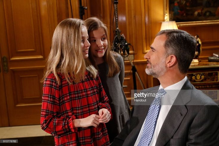 In this handout picture provided by the Spanish Royal House, Princess Leonor and princess Sofia are seen with King Felipe of Spain during the Christmas recording message on December 24, 2017 in Madrid, Spain.