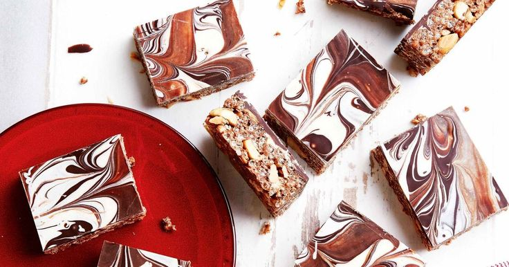 Create a gooey chocolatey treat with this Snickers and salted peanut slice.