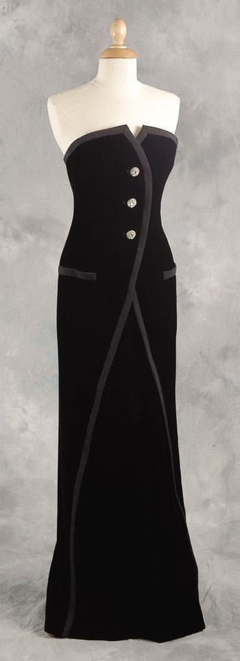 Designed by Victor Edelstein, this black silk-velvet dress cut as a pastiche of a tailcoat and edged with black ribbed silk was worn by Diana to several film premieres. She wore it March 6, 1989 to 'Dangerous Liaisons' and to 'Postcards From The Edge' on January 23, 1991, and to 'Rambling Rose' on October 29, 1991. The last film was '1492' on October 19, 1992. Also worn as part of the Vanity Fair photo shoot in July 1997, and on the November 1997 issue of Life magazine. Lot #75 raised $…