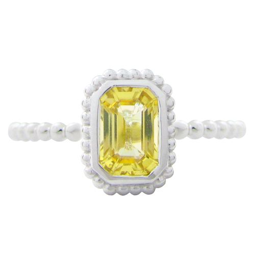 THE TESSA RING WITH YELLOW SAPPHIRE  This lovely radiant cut yellow sapphire weighs .66ct and is nestled in a 14 karat white gold granulated Tessa ring setting. This yellow sapphire ring is a size 6 which can also be sized. (R657)