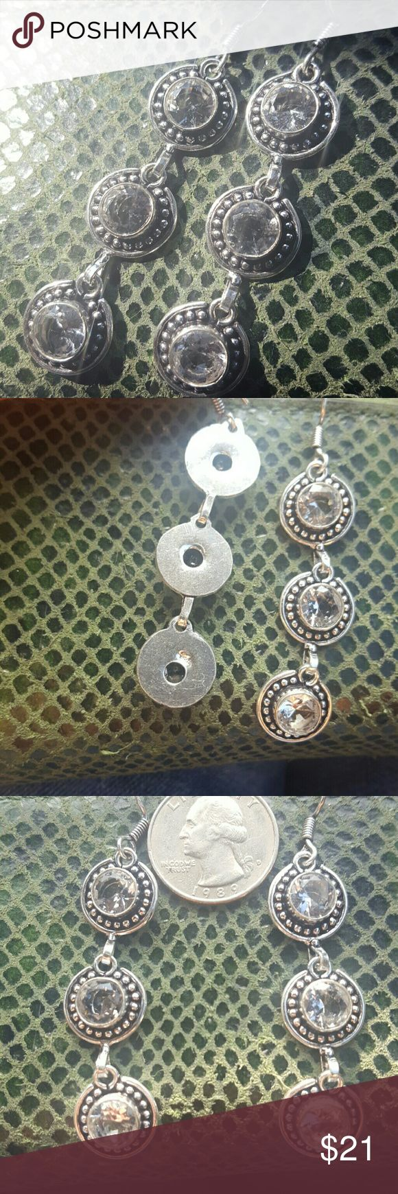 """White Topaz Earrings NWOT white Topaz Earrings earrings. Mixed silver metal. Measures 3""""  Beautiful set.  E2A  🛇No Holds🛇No Trades🛇No PayPal🛇Modeling 💰Bundle to save on shipping 🔵Use blue offer button to negotiate  📫Same or next business day shipping 💯Authentic items 😀Ask questions if the details don't explain everything.   I want you to be happy with your purchase. unbranded Jewelry Earrings"""