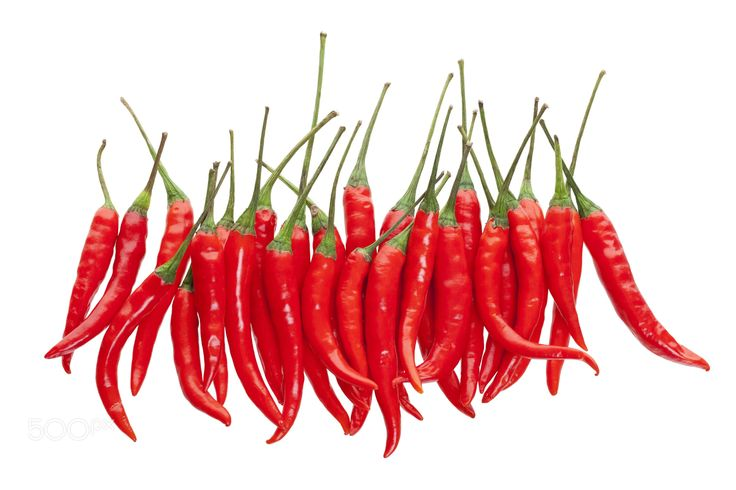 Red Chili Peppers - A bunch of red hot chili peppers shot from above on white background.