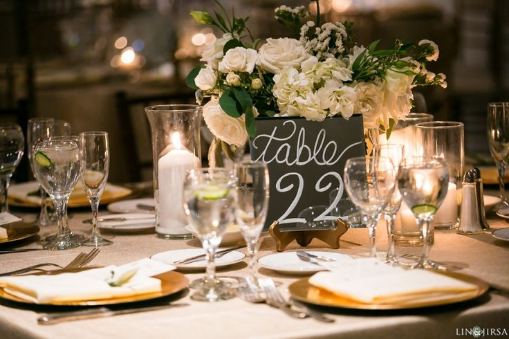 Square mirror table numbers.  Champagne and ivory wedding.