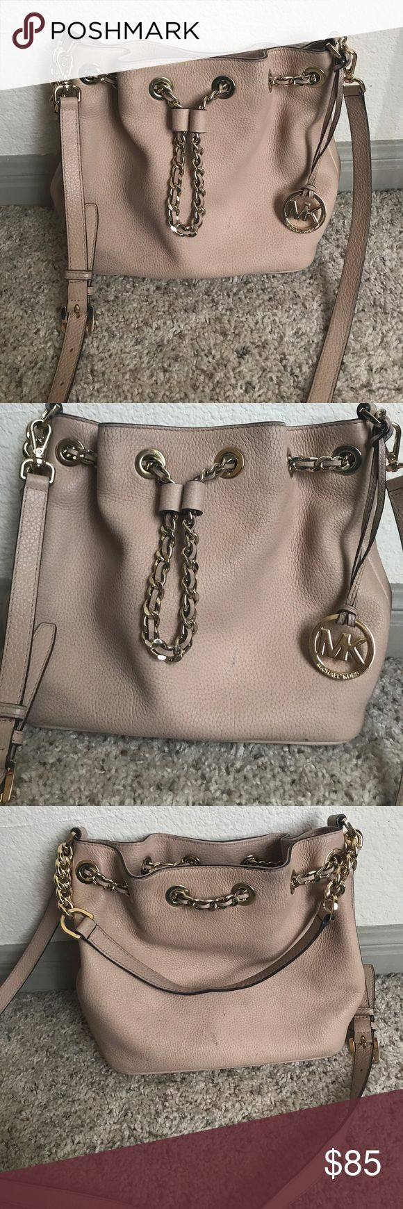 Michael Kors Neutral purse The purse is authentic and used with light wear. It's light tan leather. It has a magnetic close and cinches at the top. It has several inside pockets. There is a short strap and long detachable strap Michael Kors Collection Bags Shoulder Bags