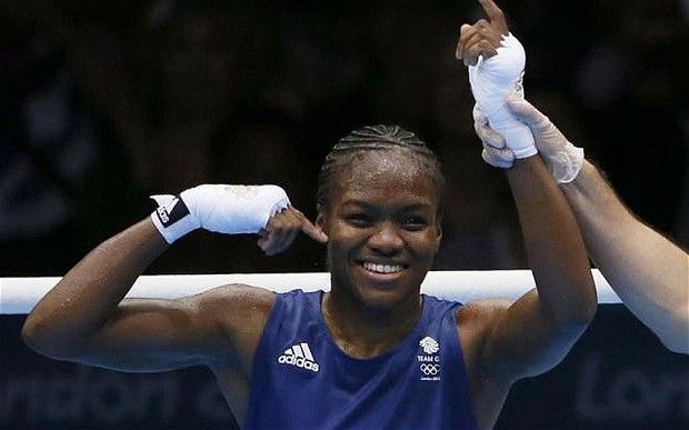 Britain's Nicola Adams wins first ever gold in Olympic women's boxing.  A beautiful smile.