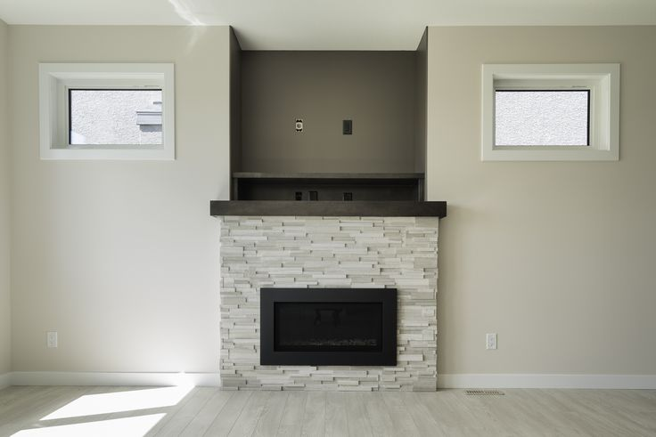 Living room fireplace feature wall with TONS of natural lighting!!