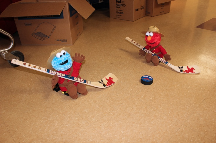 Elmo: I have an idea! Lets play some hockey first before you go because you won't be getting any exercise until you reach your new home