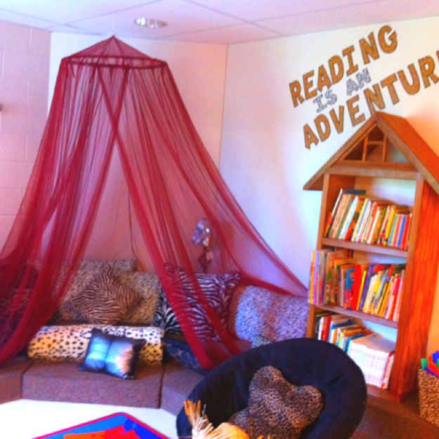 Throw some old sofa cushions on the floor. | 21 Cozy Makeshift Reading Nooks