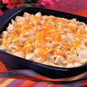 Chicken, tortillas and cheese are layered with a creamy chile-spiked sauce and baked until bubbling hot.