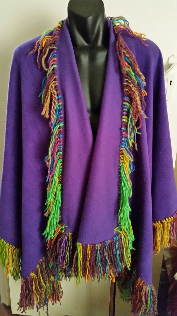 This is a Handmade by Miss Pauline Patchwork Fabric - it is a shawl/Wrap Blanket  that i have made a colourful fringe around it  - i make them to sell for $65.00 - would like one just contact me!