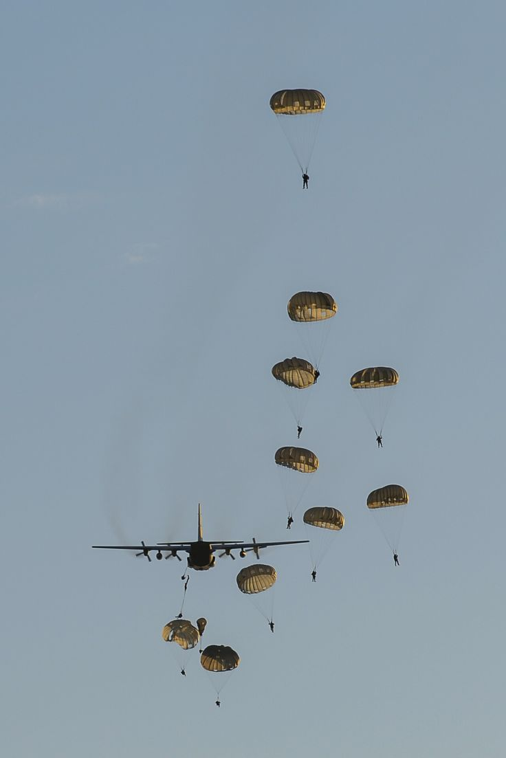 U.S. Army Soldiers with the 7th Special Forces Group perform static-line parachute jumps out of a C-130H3 Hercules during Emerald Warrior 2015 at Eglin Air Force Base, Fla., April 21, 2015. Emerald Warrior is the Department of Defense's only irregular warfare exercise, allowing joint and combined partners to train together and prepare for real-world contingency operations. (U.S. Air Force photo by Staff Sgt. Jamal D. Sutter/Released)