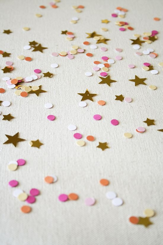 table decoration - make your own confetti with a hole puncher and left over scraps    Use silver, white, and green?