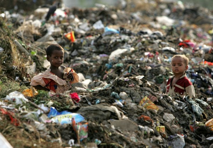 these-children-stand-waist-deep-in-a-garbage-heap-outside-new-delhi-india