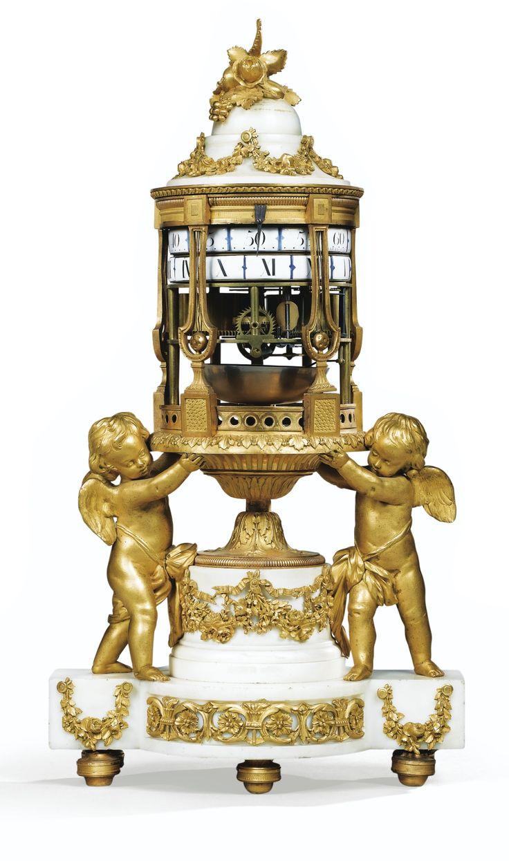 Reloj de  BRONCE DORADO MONTADO  DE LA CHIMENEA DE MÁRMOL BLANCO CERCLES-TOURNANTS, LUIS XVI, FIRMADO BARANCOURT / PARÍS