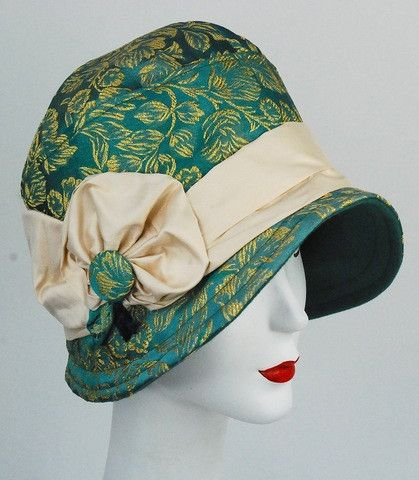 Green and gold embroidered satin cloche/flapper hat with ivory silk band