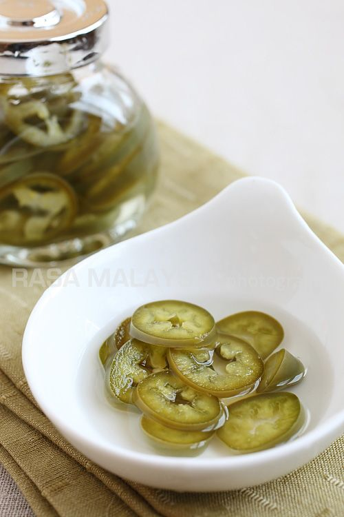 Pickled Chilies recipe - Pickled green chili is a popular condiment that accompanies many Southeast Asian street food and Asian noodle dishes. It's really painless to make and they keep for a while in the refrigerator. #malaysian #condiment