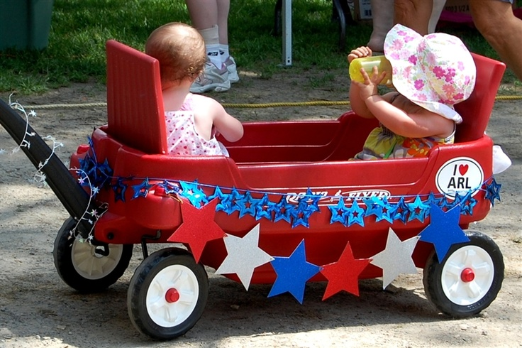 Decorated red wagon of the plastic variety. I want to get some ideas how to decorate that won't be flimsy and yet won't be permanent because the wagon is borrowed.