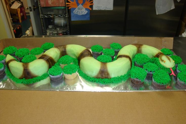 I was just going to cover the cake board in buttercream grass, but the cupcakes are an awesome idea!