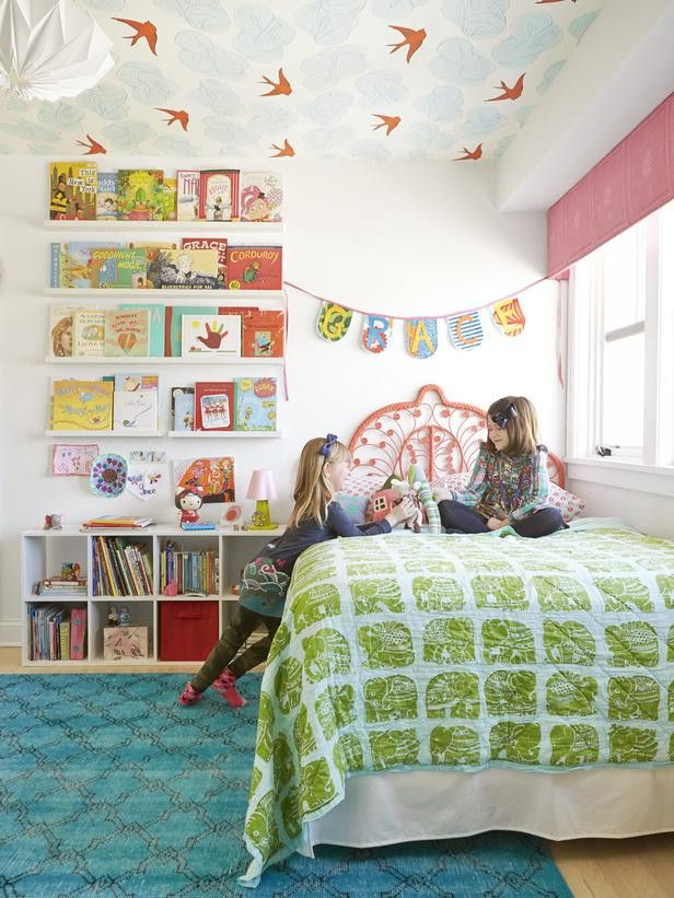 Each sister got a different color of Daydream wallpaper for their ceiling which is just about the cutest thing ever!   via HGTV Magazine. See the full house tour here!