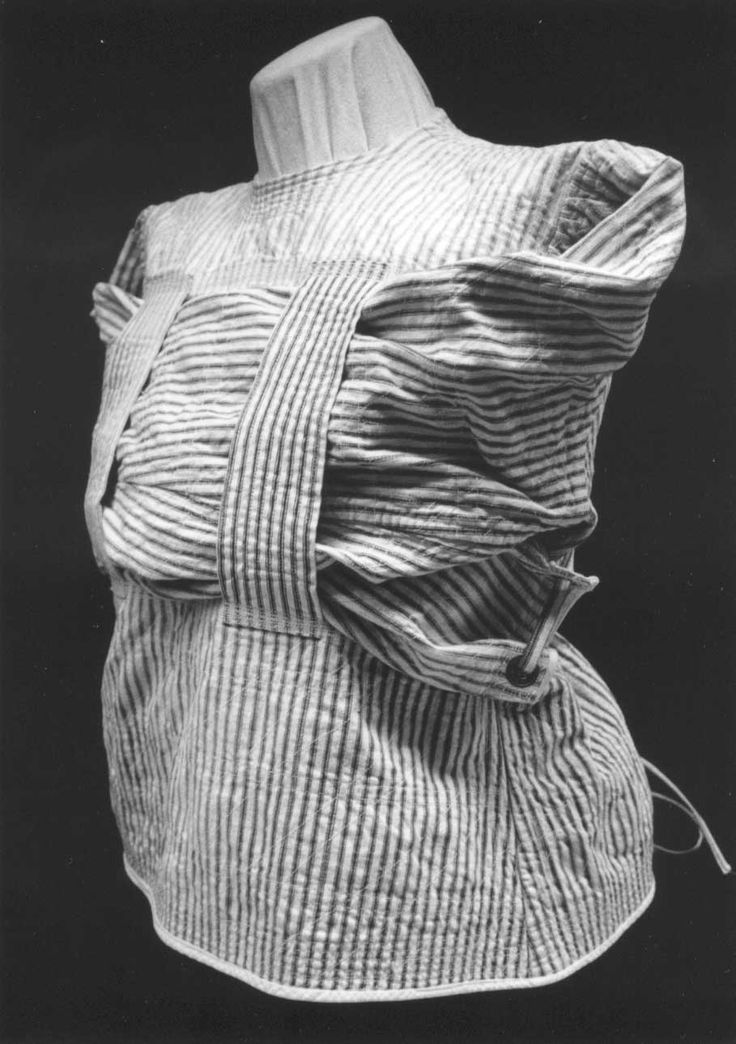 Strait Jacket, made by patients at State Hospital No. 2 in St. Joseph, Missouri from mattress ticking.