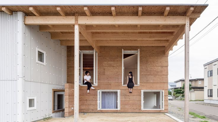 Jun Igarashi Architects found a work-around in Japanese building code to create this house on Hokkaido's southwest coast, which features a larger than average roof to protect a pair of patios from snowfall.