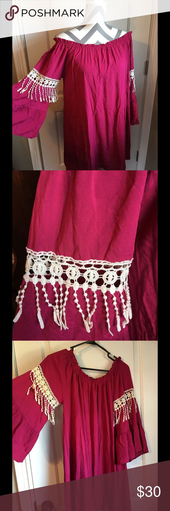 NWT Umgee Red Tunic / Dress NWT Umgee Brand Tunic / Dress with bell sleeves and ivory crochet accent on both sleeves. Can be worn on or off the shoulder. Umgee Dresses