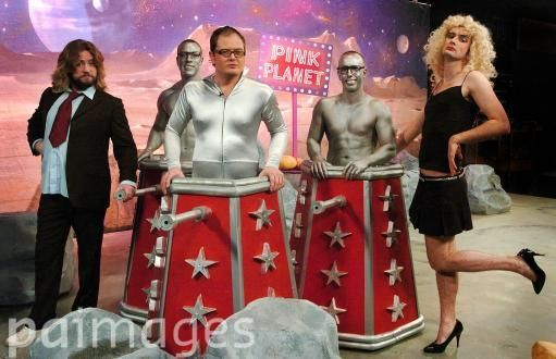 David Tennant (right) as Dr Who's assistant with Justin Lee Collins (left) as Dr Who, Alan Carr (centre) and two 'Carrleks' during a performance for the Friday Night Project (TX: Friday 5 January 2230 Channel 4) at ITV Studios in central London.