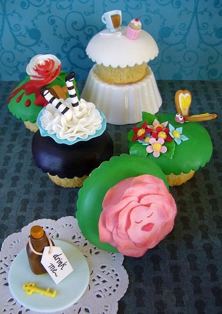 """Alice Cupcakes    These Alice in Wonderland themed cupcakes were Sugary Flower's entry in the 2011 Perth Royal Show - and they won! (nb the """"Drink Me"""" bottle & key topper at the front sat on a cupcake with a buttercream swirl)"""
