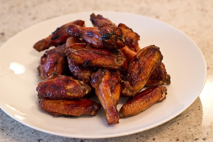 Smoked wings for 1 hour  Cover in BBQ Sauce  Cook in oven for 30 mins @ 400-450 degrees  Add tiny bit more BBQ sauce    Die happy    http://www.seerecipe.com