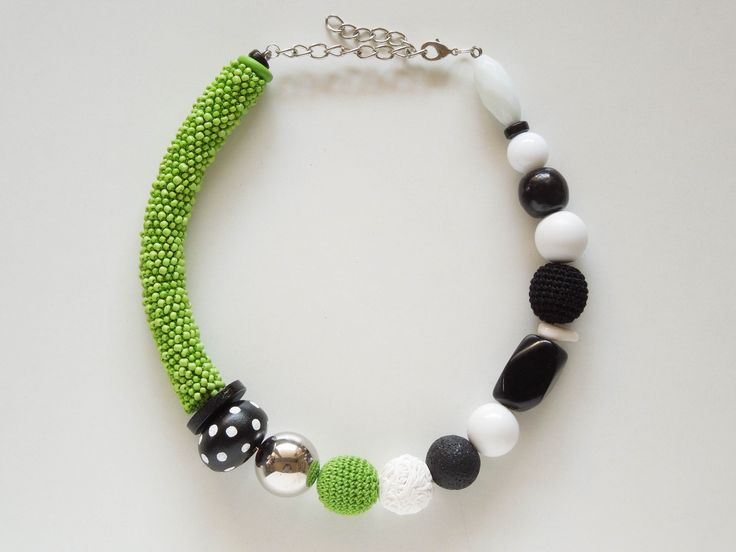 Green Black and White asymmetric necklace with crocheted seed beads and other big handmade beads. #ivadidit