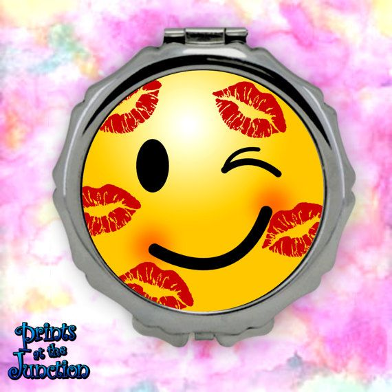 Emoji compact mirror/cute emoji kiss face compact purse mirror/cute emoji with lipstick kisses travel cosmetics purse mirror featuring a blushing emoji adorned with lipstick kisses. Fun gift idea for beauticians and teens.