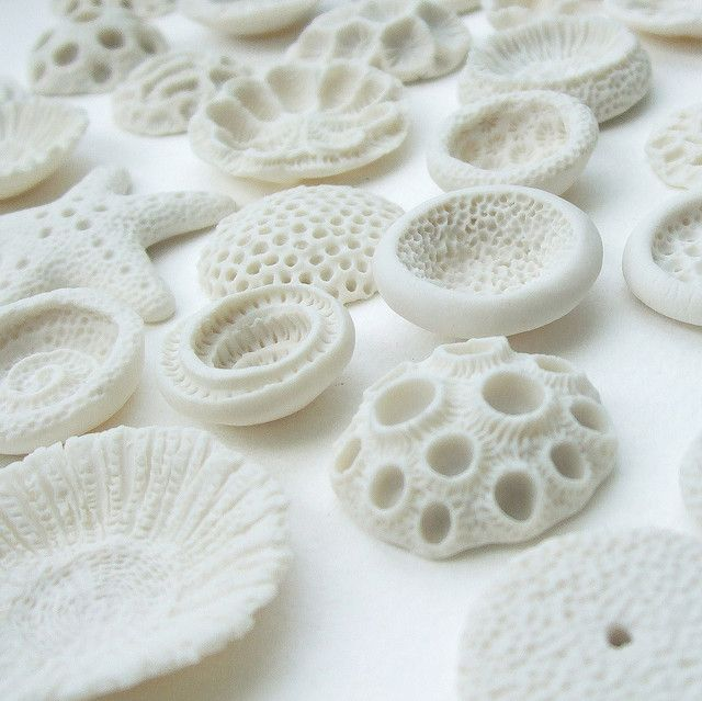 High fired semi translucent porcelain....unglazed    I have been accepted to the CREATE Christmas Fair in December! Yay! Which is fairtrade, recycled, environmentally friendly, locally produced, etc....so these are my vegan corals....and I'm going to be making some batches using purely reclaimed glass too.