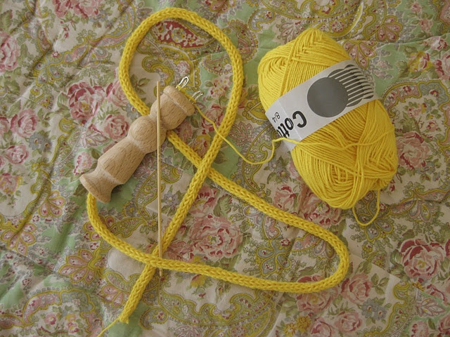 A crocheted cord.  I haven´t done this since my youth. But it would be fun to give it a try again. I remember getting sore fingers trying to get the yarn over the nails. :)