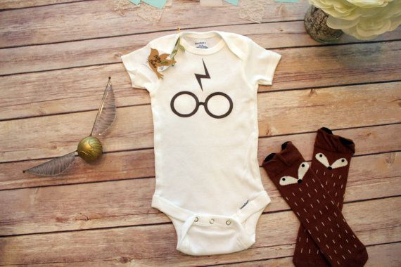 Unisex Harry Potter baby Onesie® perfect for a boy (or girl) with the iconic glasses and lighting bolt graphic print image across the front.…