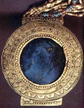 Egyptian  Lapis and gold bracelet from the tomb of Tutankhamun. 1325 B.C.  Scanned  photograph taken from Tutankhamun:  His Tomb  and His Tr...