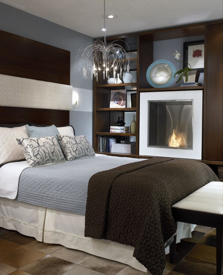 Amazing - fireplace in the bedroom!  Candice Olson design tip: WHERE is the best place for a fireplace in your bedroom, and how to get one without having a chimney!