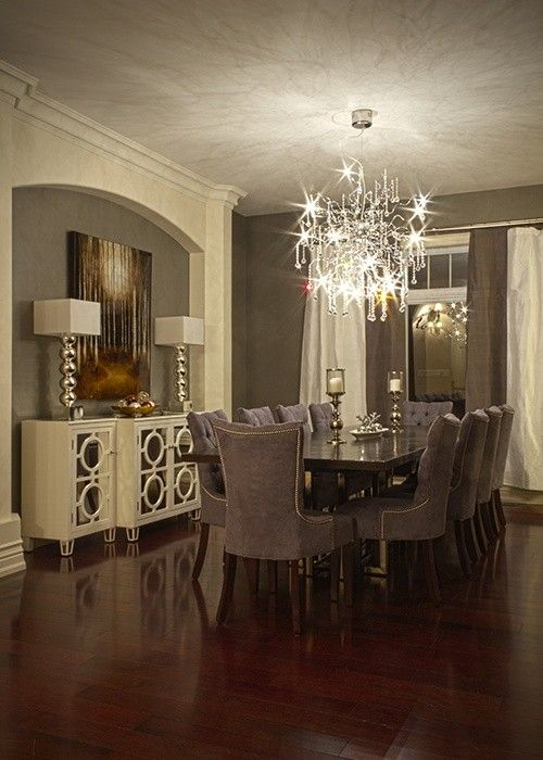 gray/cream dining room, with a great chandelier ...