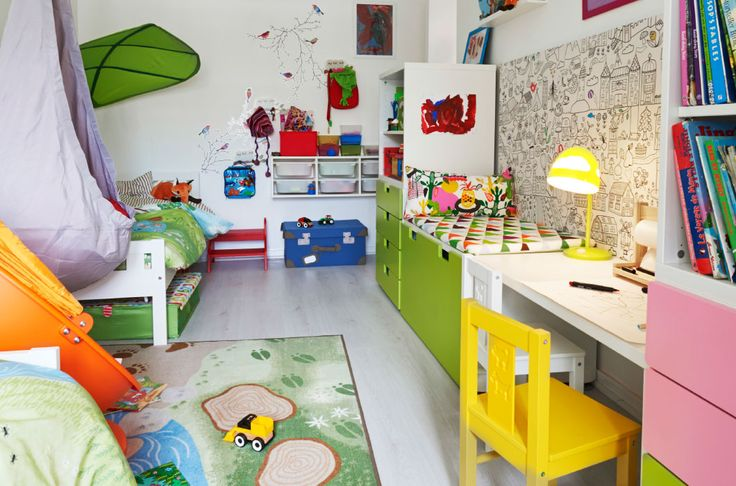 View of colorful shared kids' bedroom with a clever layout and multi-functional storage solutions.