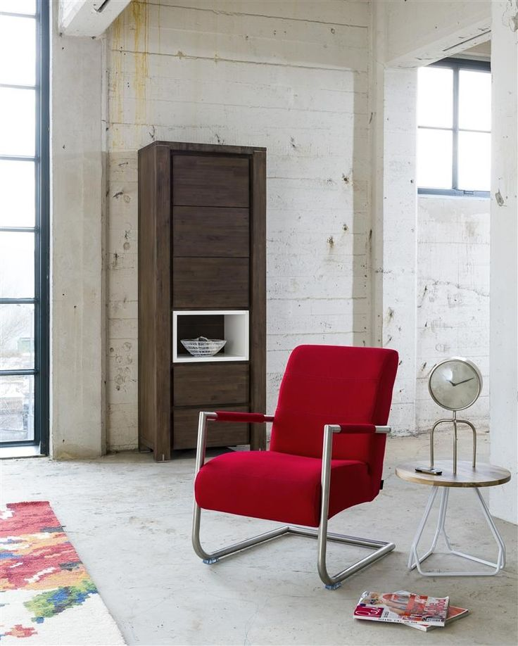 Angelica armchair with stainless steel frame, available in fabric or leather. The cupboard has LED lighting to creat more atmosphere.